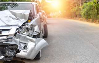 Silver car damaged after road traffic collision