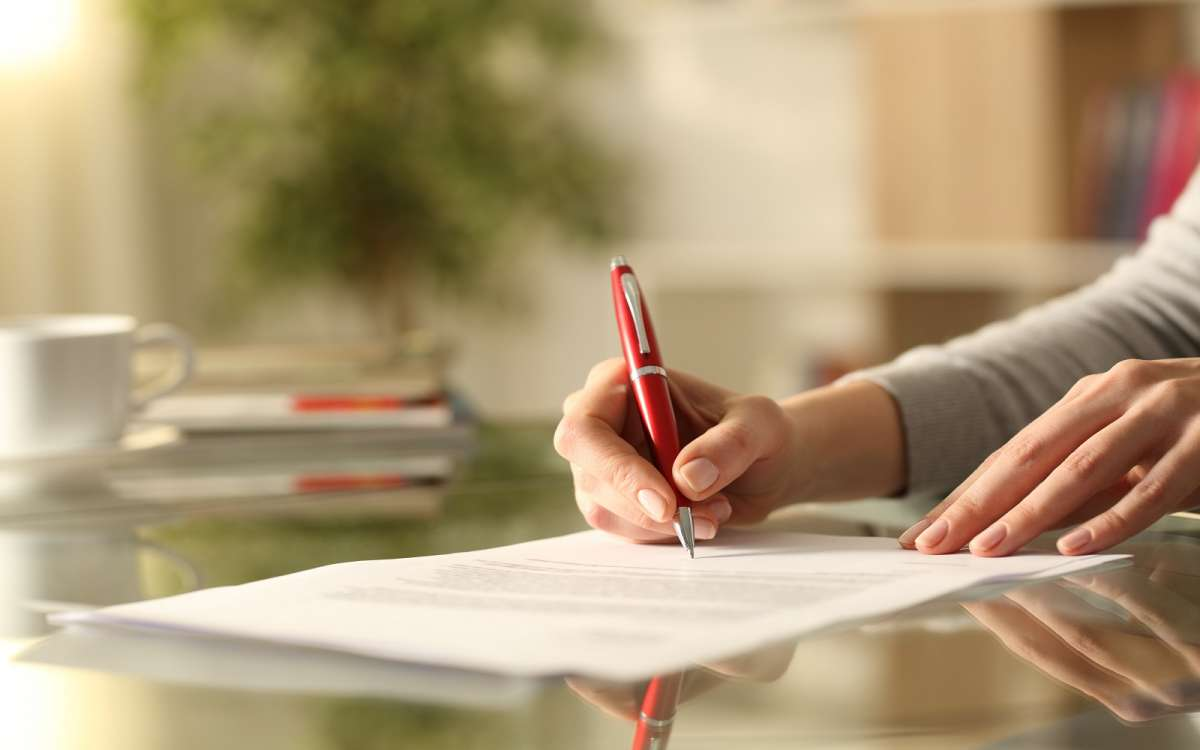 woman signing a will