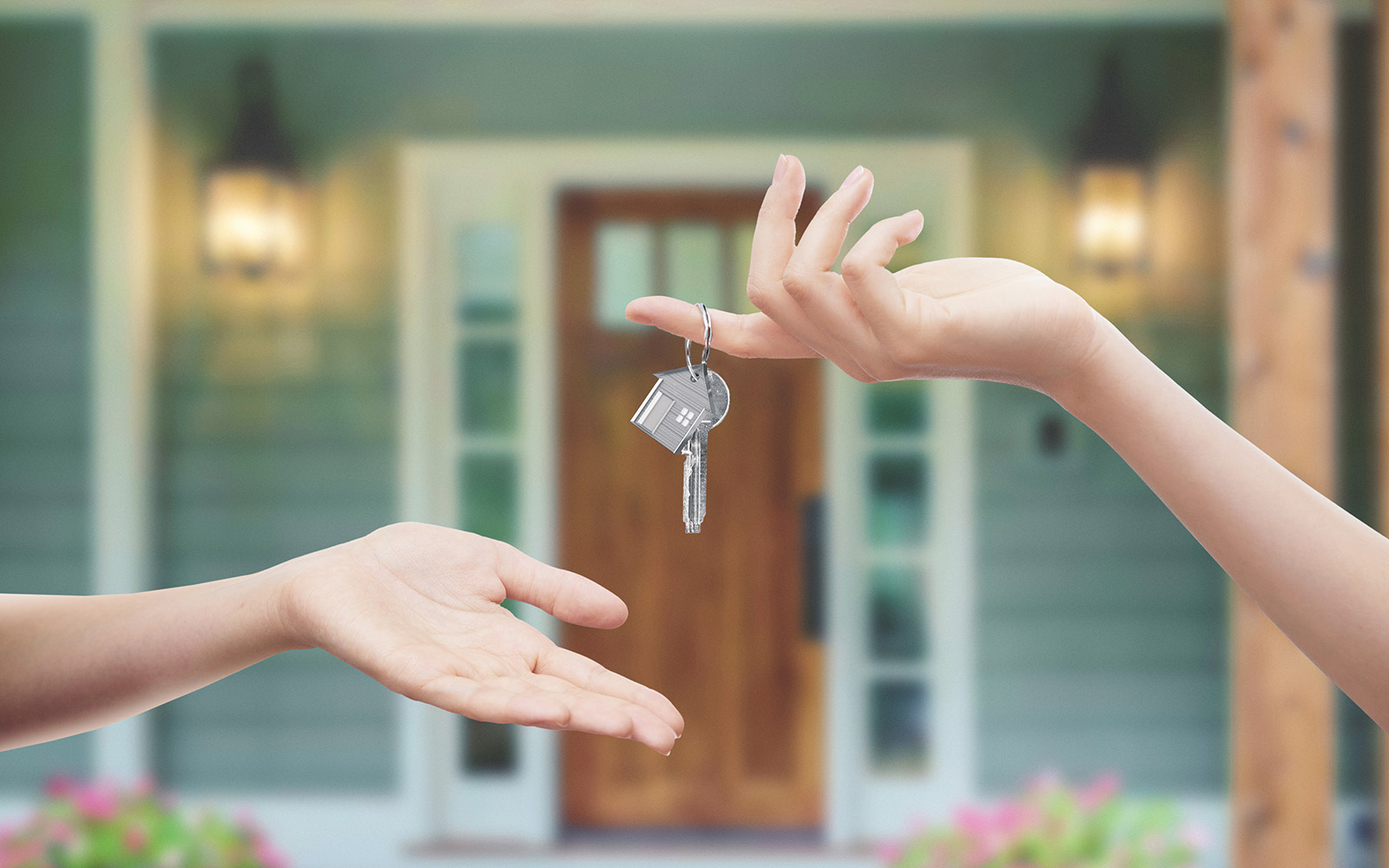 former owner giving new owner key to their new home