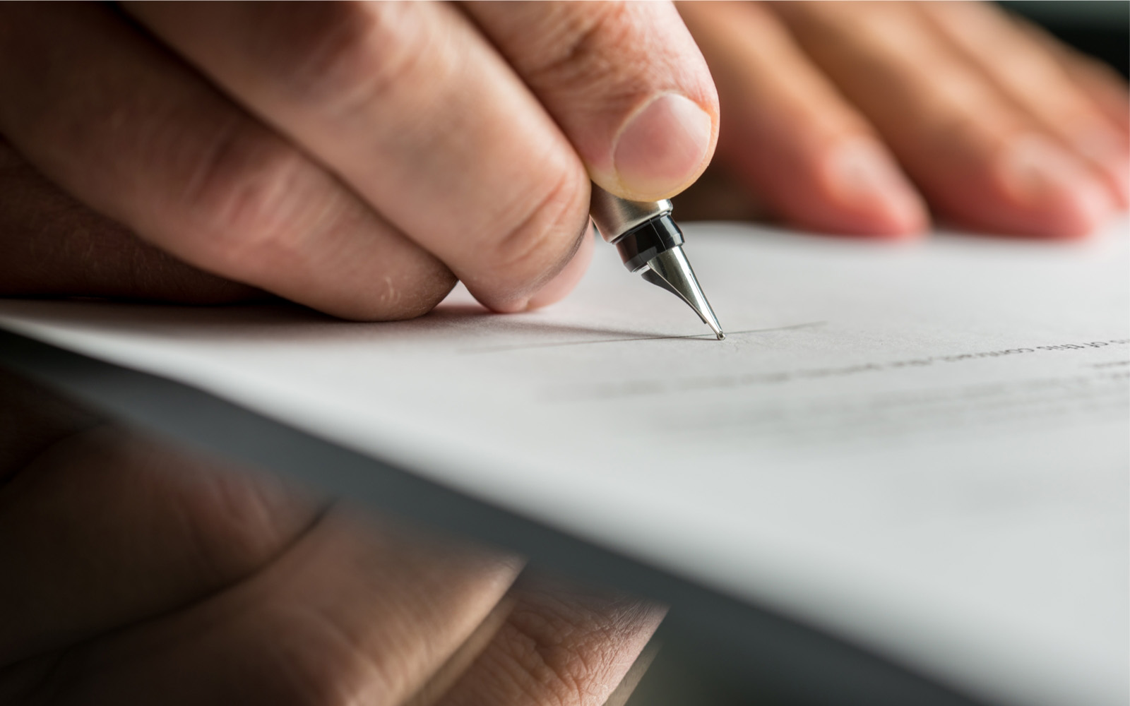 man signing last will and testament